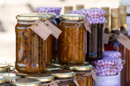 jars with passion fruit jams at the street fair