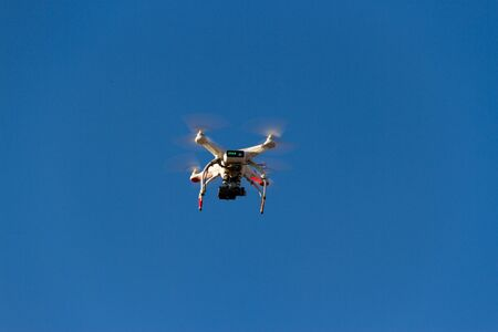 a drone that photographs flying in the blue sky