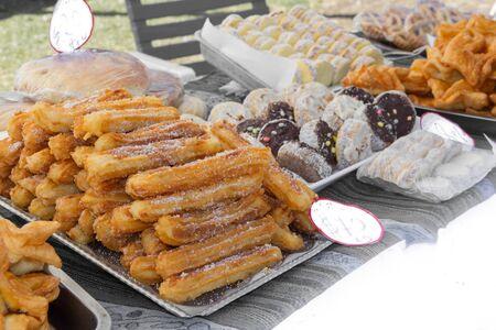 sweet churros and alfajores for sale at the street fair