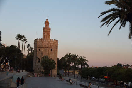 Seville, Spain - June 9 2019: sunset view of the Torre del Oro