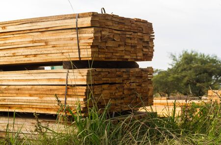 wood boards stacked for drying process in the sawmill