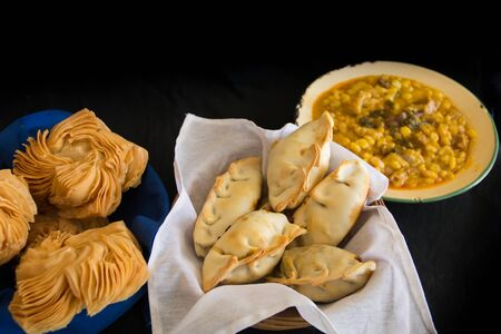 dishes of locro empanadas and sweet pastries, traditional Argentine foods that are frequently consumed for national holidays, such as the revolution of May 25 and independence on July 9