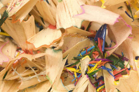Colored pencils shavings scattered throughout the plane photo