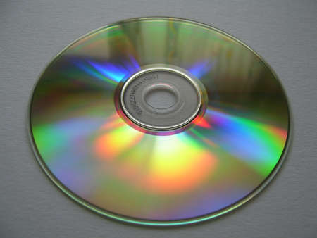 dvdr: a rainbow colored cd on grey background Stock Photo