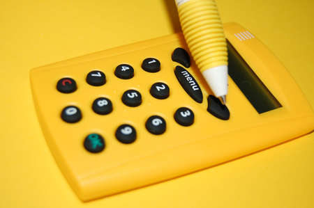 figuring: the calculator and pen Stock Photo