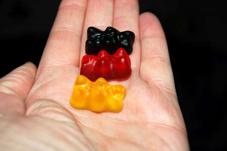 black,red and yellow in the hand