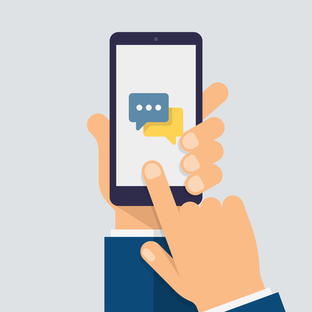 Message icon on smartphone screen. Hand holds the smartphone and finger touches screen. Modern vector flat design.