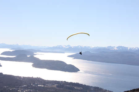 flying float: Paragliding Over Lake Stock Photo
