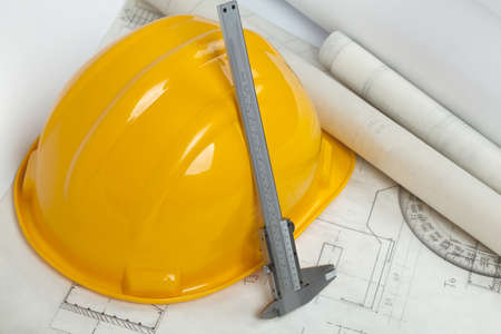 Blueprints and construction tools on table photo