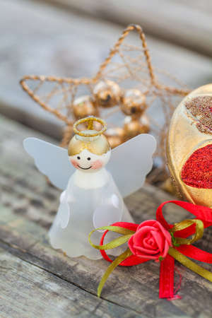 composition of christmas ornaments and angel on wood photo