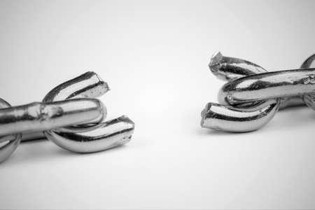 Black and white macro shot of broken chain