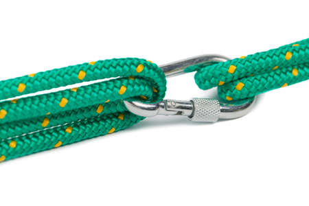 descender: Macro shot of carabiner with rope on blank background