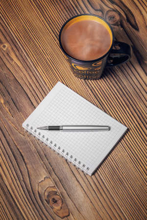 notepaper: notepaper coffee cup and pen on wood table