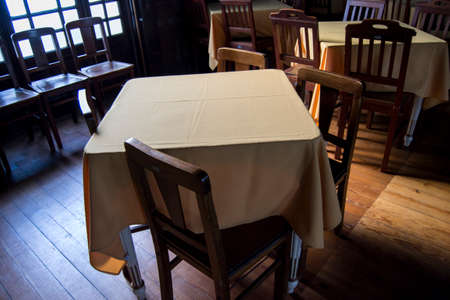 clothe: Set table with yellow clothe, 4 wooden chairs and wooden floor