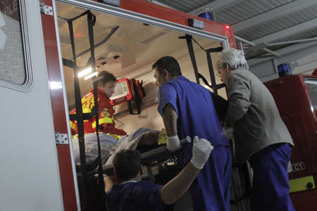 intubation: Bucharest, Romania, 31 October 2015: Romanian paramedics transfer a wounded person, who survived from a fire at a club from the Emergency Hospital Floreasca to a burn center. Romanian Interior Ministry stated 27 people were killed and 162 were injured, in