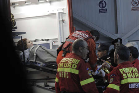 life threatening: Bucharest, Romania, 31 October 2015: Romanian paramedics transfer a wounded person, who survived from a fire at a club from the Emergency Hospital Floreasca to a burn center. Romanian Interior Ministry stated 27 people were killed and 162 were injured, in