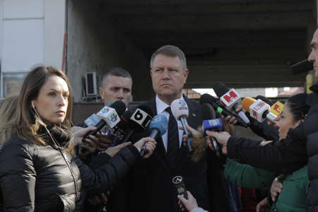klaus: Romanian President Klaus Iohannis makes a statement after the visit at the place of fire where 28 people died and over 160 were injured, in Bucharest, capital of Romania,  31 October, 2015.