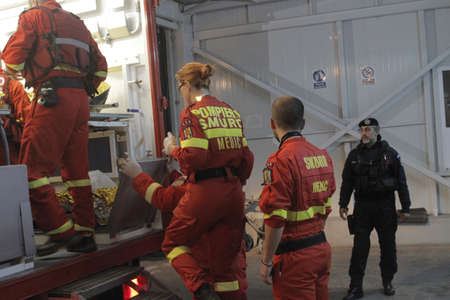 bucuresti: Bucharest, Romania, 31 October 2015: Romanian paramedics transfer a wounded person, who survived from a fire at a club from the Emergency Hospital Floreasca to a burn center. Romanian Interior Ministry stated 27 people were killed and 162 were injured, in