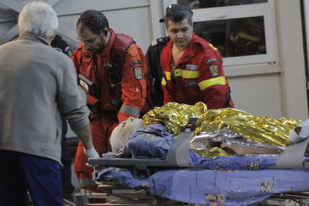 paramedics: Bucharest, Romania, 31 October 2015: Romanian paramedics transfer a wounded person, who survived from a fire at a club from the Emergency Hospital Floreasca to a burn center. Romanian Interior Ministry stated 27 people were killed and 162 were injured, in
