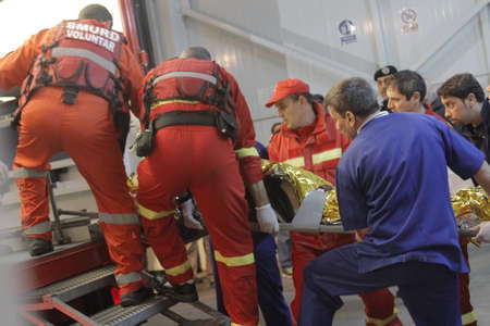 stated: Bucharest, Romania, 31 October 2015: Romanian paramedics transfer a wounded person, who survived from a fire at a club from the Emergency Hospital Floreasca to a burn center. Romanian Interior Ministry stated 27 people were killed and 162 were injured, in