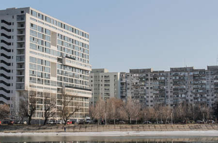 periphery: Bucharest, Romania, 7 February 2016: Landscape with tall residential blocks and lake in a Bucharest suburb. Editorial