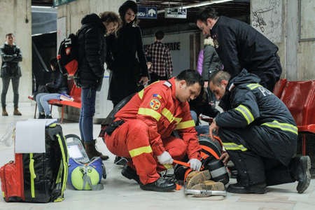 intervenes: Bucharest, Romania, 13 February 2016: SMURD ( Mobile Emergency Service for Resuscitation and Extrication) intervenes for reanimate a lady who fainted in the subway station Universitate, in Bucharest.