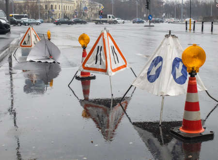 Bucharest, Romania, 27 February 2016: Public works delimited with barriers and signs in Bucharest.