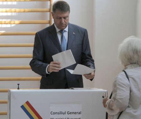 balloting: BUCHAREST, ROMANIA - MAY 05, 2016: Romanian President Klaus Iohannis casts his vote in local elections.