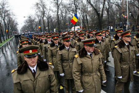 paramilitary: BUCHAREST, ROMANIA - DECEMBER 1, 2010: Military are taking part to a military parade on National Day of Romania. More than 3,000 soldiers and personnel from security agencies take part in the massive parades on National Day of Romania.