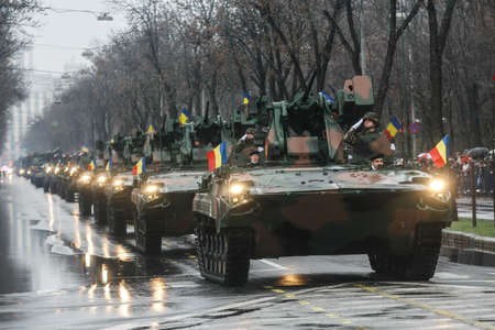 paramilitary: BUCHAREST, ROMANIA - DECEMBER 1, 2010: Military on heavy vehicles are taking part to a military parade on National Day of Romania. More than 3,000 soldiers and personnel from security agencies take part in the massive parades on National Day of Romania.