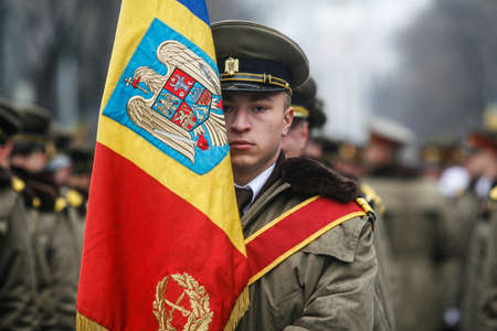 BUCHAREST, ROMANIA - DECEMBER 1, 2010: A soldier is taking part to a military parade on National Day of Romania. More than 3,000 soldiers and personnel from security agencies take part in the massive parades on National Day of Romania. Editorial