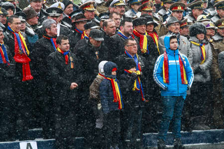 BUCHAREST, ROMANIA - DECEMBER 1, 2014: Officials are taking part to a military parade on National Day of Romania. More than 3,000 soldiers and personnel from security agencies take part in the massive parades on National Day of Romania.