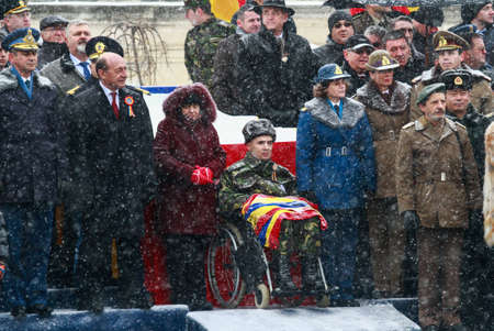 BUCHAREST, ROMANIA - DECEMBER 1, 2014: A war veteran is taking part, next to the Romanian president and other officials, to a military parade on National Day of Romania. More than 3,000 soldiers and personnel from security agencies take part in the massiv