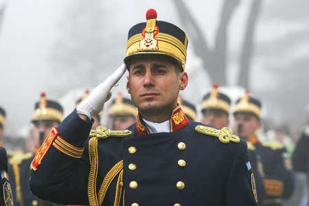 paramilitary: BUCHAREST, ROMANIA - DECEMBER 1, 2008: A military from the National Guard salutes during a military parade. More than 3,000 soldiers and personnel from security agencies take part in the massive parades on National Day of Romania. Editorial