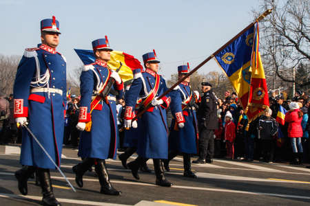 paramilitary: BUCHAREST, ROMANIA - DECEMBER 1, 2013: Military are taking part to a military parade on National Day of Romania. More than 3,000 soldiers and personnel from security agencies take part in the massive parades on National Day of Romania.