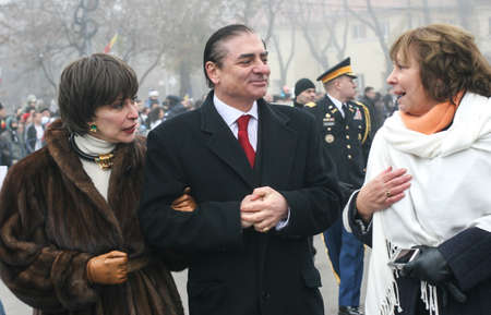 BUCHAREST, ROMANIA - DECEMBER 1, 2008: Prince Paul of Romania and Princess Lia are taking part to a military parade on National Day of Romania. More than 3,000 soldiers and personnel from security agencies take part in the massive parades on National Day