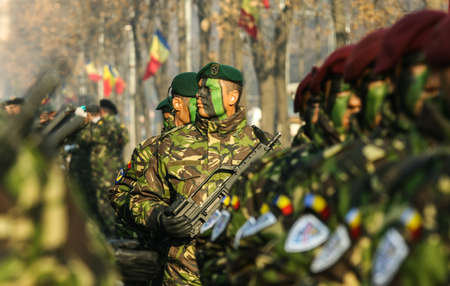 BUCHAREST, ROMANIA - DECEMBER 1, 2011: Military are marching during a military parade in Bucharest. More than 3,000 soldiers and personnel from security agencies take part in the massive parades on National Day of Romania. Editorial