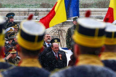 BUCHAREST, ROMANIA - DECEMBER 1, 2014: Romanian president Traian Basescu is taking part to a military parade on National Day of Romania. More than 3,000 soldiers and personnel from security agencies take part in the massive parades on National Day of Roma