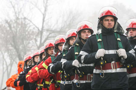 BUCHAREST, ROMANIA - DECEMBER 1, 2008: Soldiers from the fire department are marching during a military parade in Bucharest. More than 3,000 soldiers and personnel from security agencies take part in the massive parades on National Day of Romania. Editorial