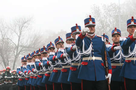 paramilitary: BUCHAREST, ROMANIA - DECEMBER 1, 2008: Soldiers are marching during a military parade in Bucharest. More than 3,000 soldiers and personnel from security agencies take part in the massive parades on National Day of Romania.