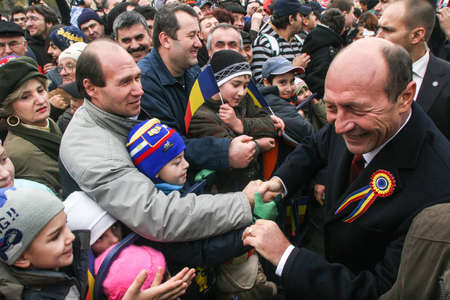 paramilitary: BUCHAREST, ROMANIA - DECEMBER 1, 2009: Romanian president Traian Basescu is taking part to a military parade on National Day of Romania. More than 3,000 soldiers and personnel from security agencies take part in the massive parades on National Day of Roma