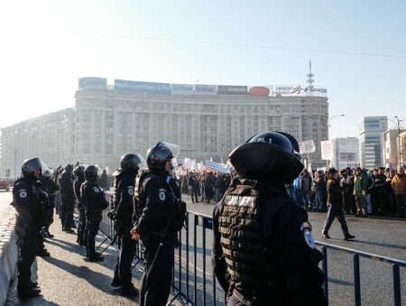 governmental: Bucharest, Romania, January 26, 2016: Romanian Gendarmes are participating to a protest in front of the Governmental building, in Bucharest.