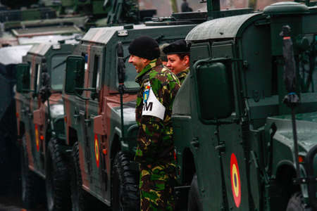 paramilitary: BUCHAREST, ROMANIA - DECEMBER 1, 2014: Military are taking part to a military parade on National Day of Romania. More than 3,000 soldiers and personnel from security agencies take part in the massive parades on National Day of Romania.