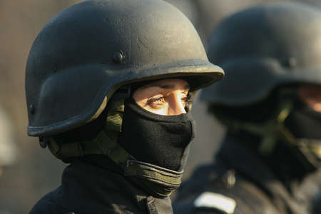 paramilitary: BUCHAREST, ROMANIA - DECEMBER 1, 2011: Military are marching during a military parade in Bucharest. More than 3,000 soldiers and personnel from security agencies take part in the massive parades on National Day of Romania. Editorial