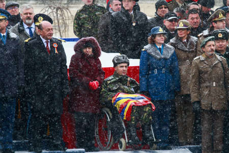paramilitary: BUCHAREST, ROMANIA - DECEMBER 1, 2014: A war veteran is taking part, next to the Romanian president and other officials, to a military parade on National Day of Romania. More than 3,000 soldiers and personnel from security agencies take part in the massiv