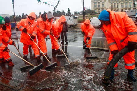 BUCHAREST, ROMANIA, DECEMBER 1, 2014: Public service workers are working on swage after heavy precipitations in Bucharest.