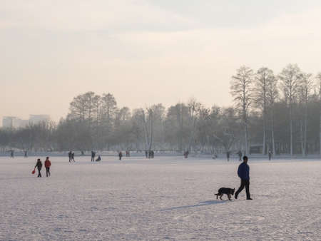 Bucharest, Romania, January 24, 2016: People are walking on a frozen lake in Bucharest for ice fishing. Editorial