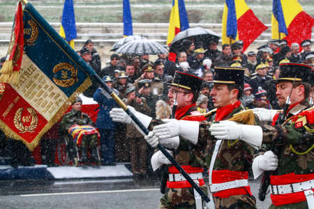 BUCHAREST, ROMANIA - DECEMBER 1, 2014: Military are taking part to a military parade on National Day of Romania. More than 3,000 soldiers and personnel from security agencies take part in the massive parades on National Day of Romania.