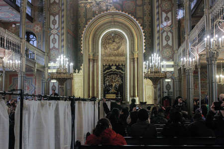 Bucharest, Romania, January 31, 2016: People are participating to a religious service inside the Coral Temple in Bucharest.