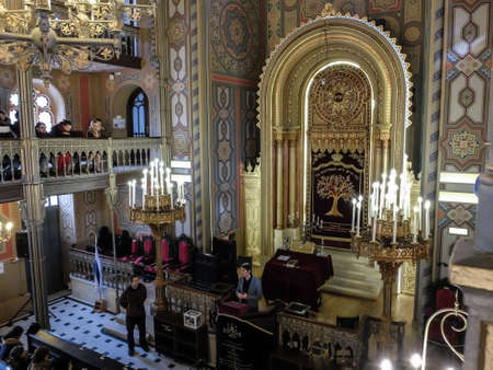 shool: Bucharest, Romania, January 31, 2016: People are participating to a religious service inside the Coral Temple in Bucharest.
